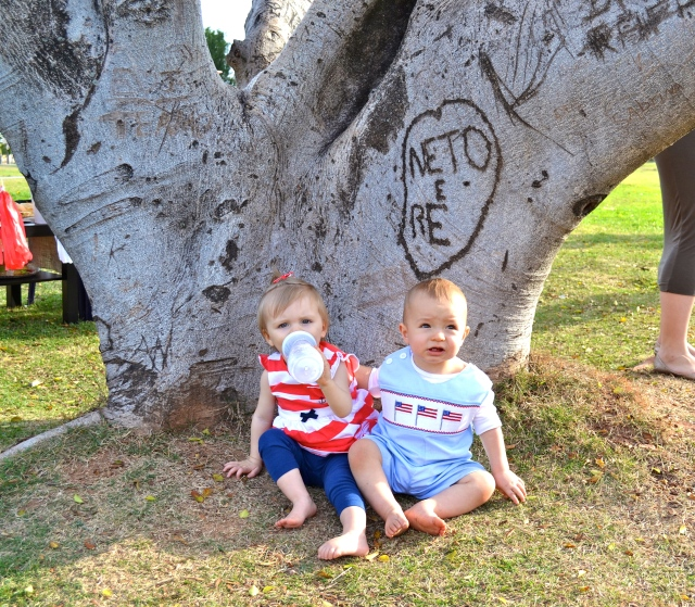 Colt with his arm around Mailey, just sitting under the tree, pretending their names are Neto & Re...