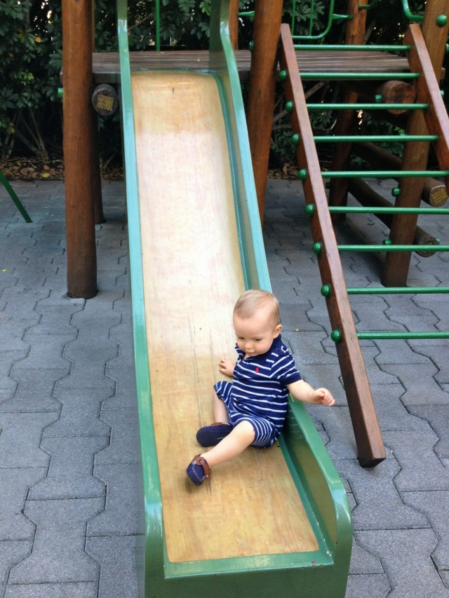 Colt always climbs onto the slide and tries to walk up as far as he can.