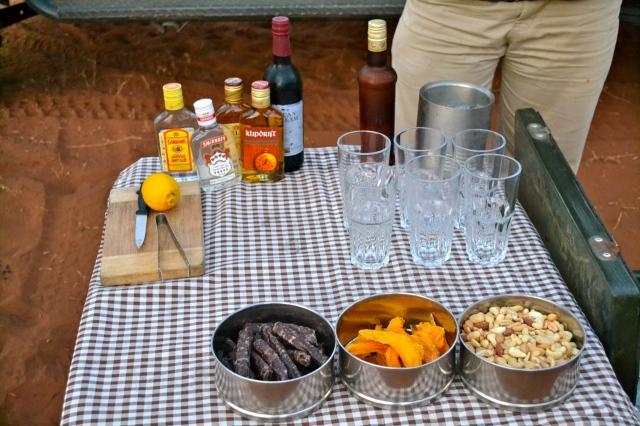 Sundown setup: dried sausages, dried mango, nuts and DRINKS!