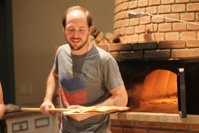 Trent manning the pizza oven.