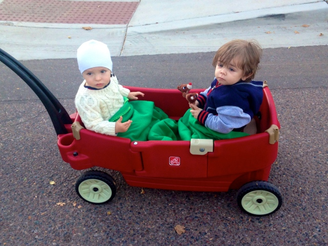 JJ and Colt (wearing a hat that officially looks like a swim cap) riding along in the wagon.