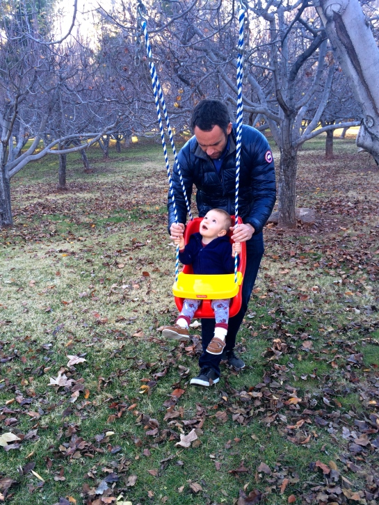 Colt swinging with Uncle Joe.