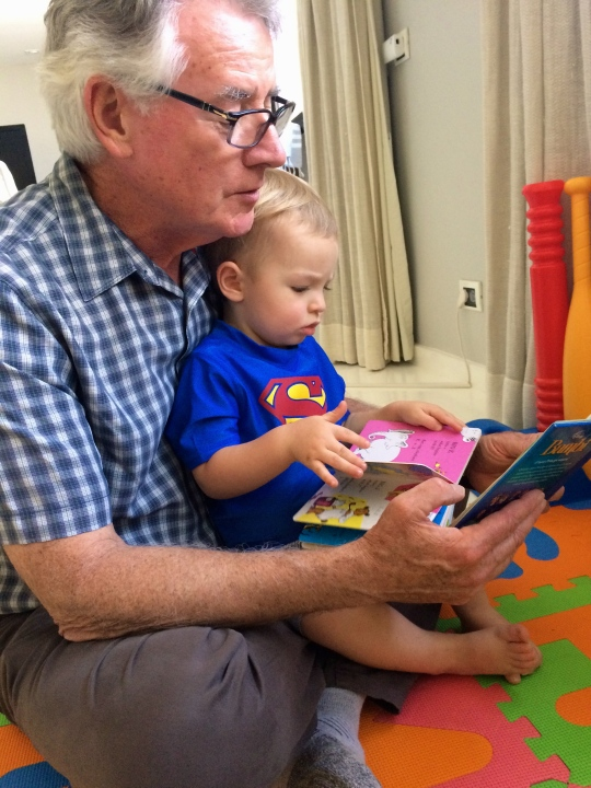 Ollie reading with Superman.