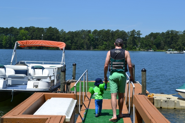 Michael walking little Colt out on the dock.