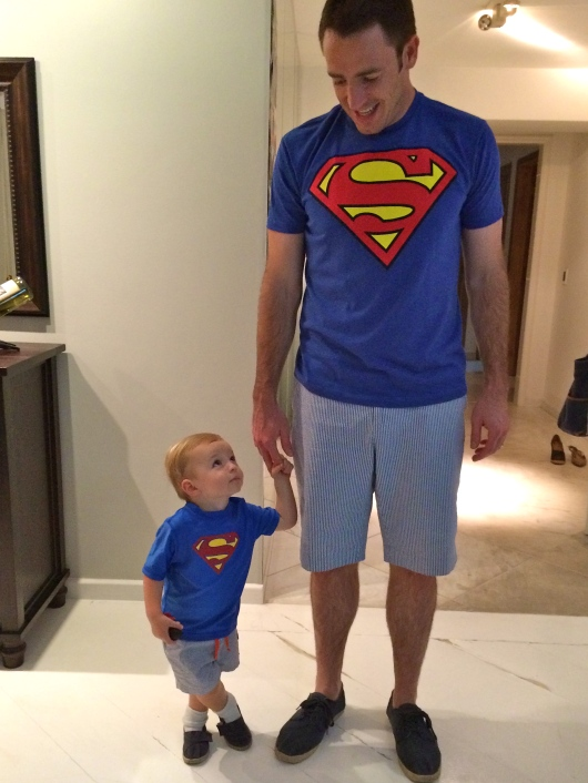 They love to dress alike. Especially when it's Superman!
