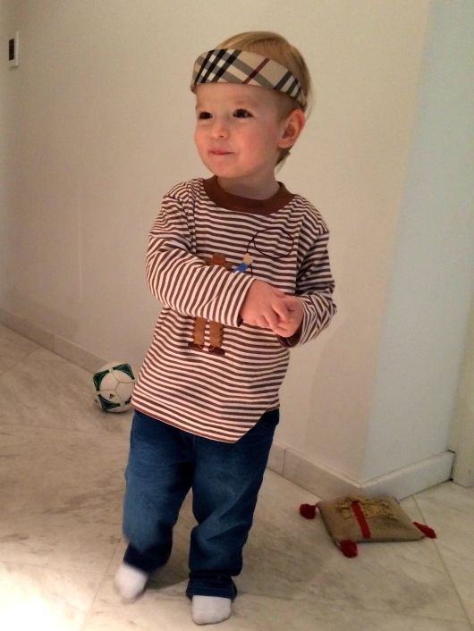 Playing with Mom's headband. Honestly looks better on him.