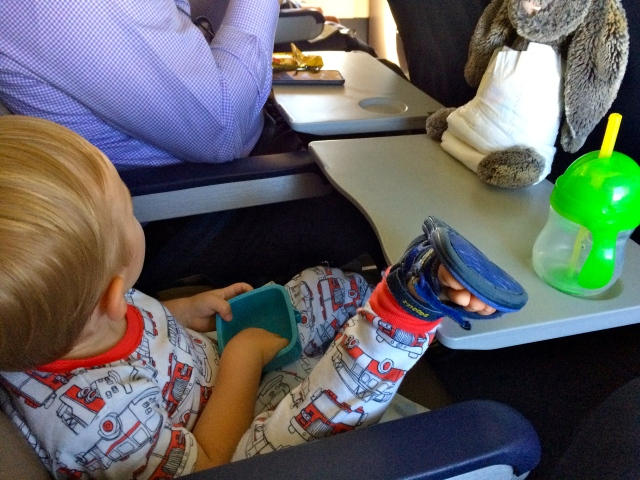 Right at home on the plane. And yes, he put a diaper on his bunny.