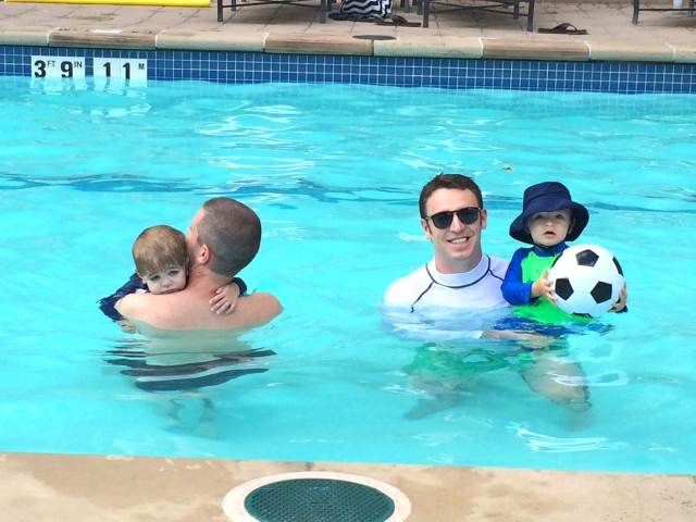 Dads and boys, swimming in the pool.