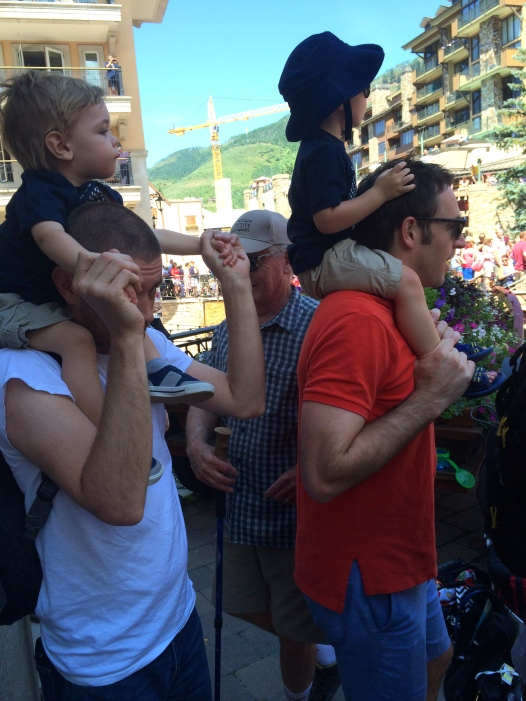 Colt and JJ captivated by the 4th of July parade.