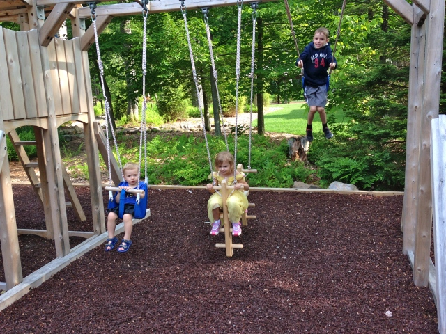 Colt, Augusta Clare (my brother's daughter) and Gavin (my 1st cousin's son) playing on the swings.