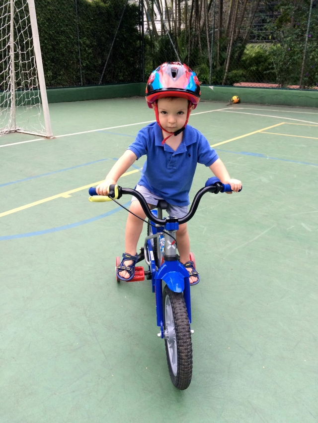 Riding a bike! He could honestly do this allllll day long.