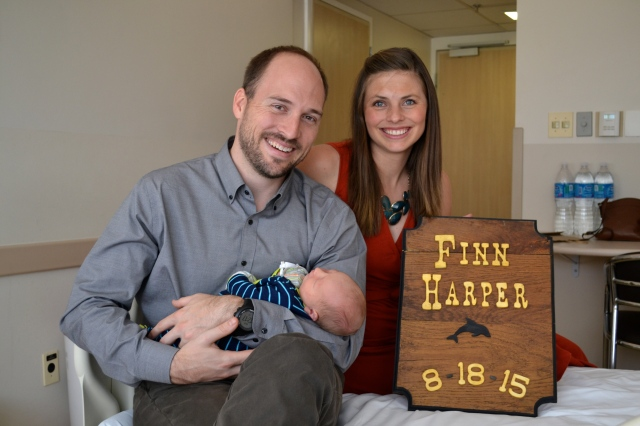 Finn meeting his Godparents, Trent & Paige Hudson! Trent made Finn a sign to match his big brother's!