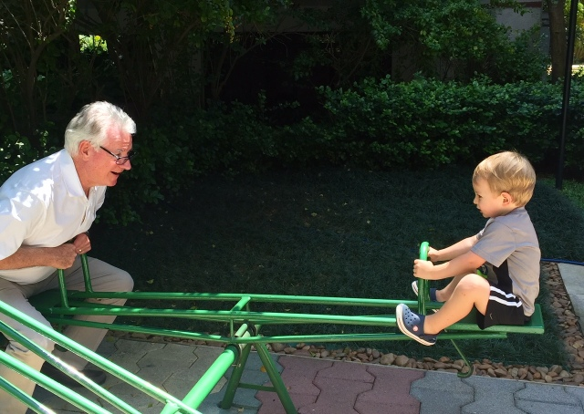 Papa & Colt on the seesaw.