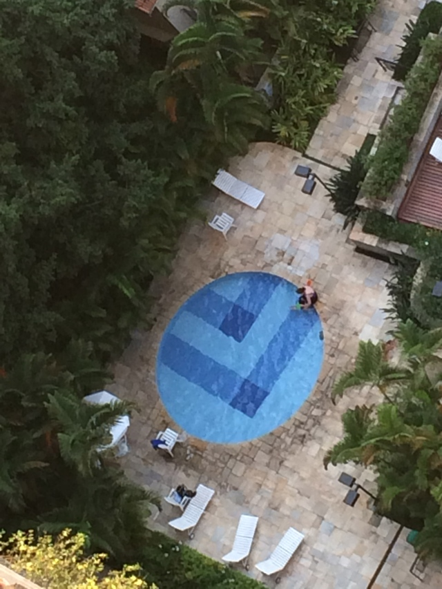 Nana taking Colt for an afternoon swim. (Photo sneakily taken from our apartment - 26 floors up!)
