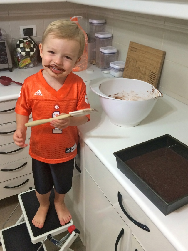 Baking brownies with Mom! Had to really convince him to try the batter but of course he loved it.